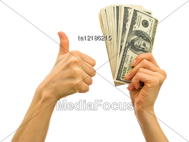 Bundle Of Money In The Hand - Symbol Of Success In Business Stock Photo
