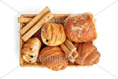 Buns With Raisins, Bread Sticks, Croissants, Puff Bun With Grit In A Wicker Basket Stock Photo
