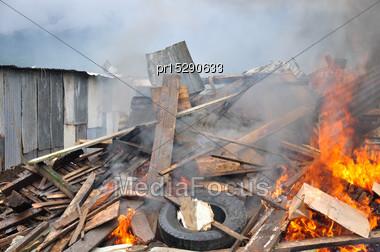 Burning A Demolishing Building Stock Photo