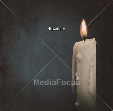 Burning Candle Over Dark Backgrounds. Abstract Grungy Still Life Stock Photo