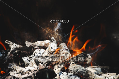 Burning Flame And Firewoods As Abstract Backgrounds Stock Photo