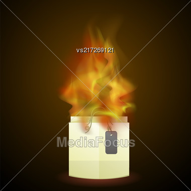 Burning Paper Shopping Bag Isolated On Dark Background Stock Photo