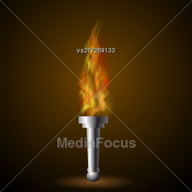 Burning Torch With Fire Flame On Dark Background Stock Photo
