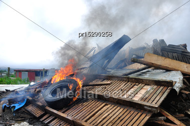 Burning Tyre On A Rubbish Pile Stock Photo