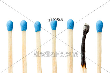 Burnt Match And A Whole Blue Matches Stock Photo