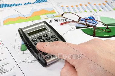 Business Concept. Businessman Working With A Financial Documents Stock Photo