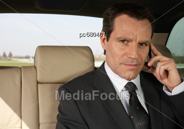 Business Man on Cell Phone In The Car Stock Photo