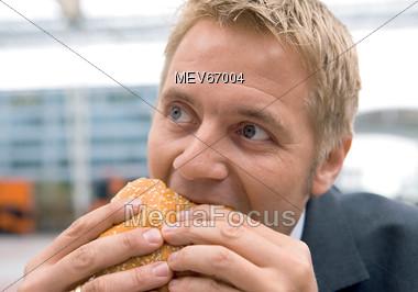 Business Man Eating Burger Stock Photo