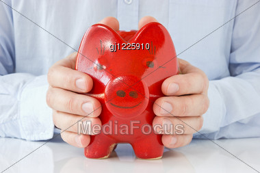 Business Man Holding Piggy Bank , Concept For Money Protection Stock Photo