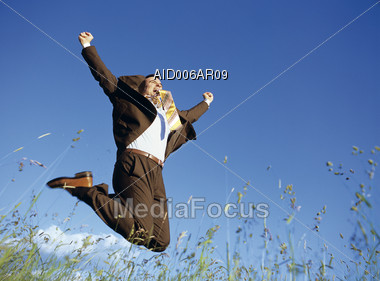 Business Man Jumping in Joy Stock Photo