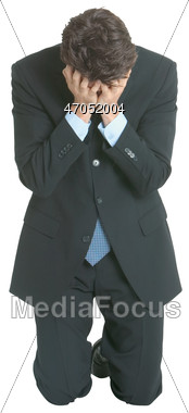 Business Man Kneeling Face In Hands Stock Photo