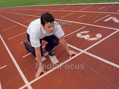 Business Man Running a Race Stock Photo