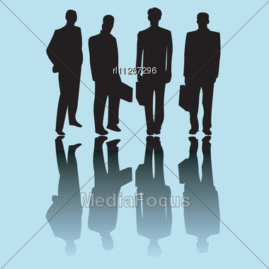 Business Man Silhouettes On Blue Background Stock Photo