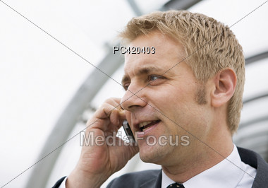 Business Man Talking On Cell Phone Outside Stock Photo