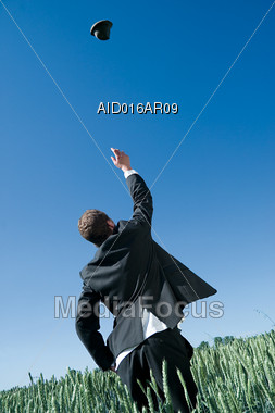 Business Man Throwing Hat in the Air Stock Photo