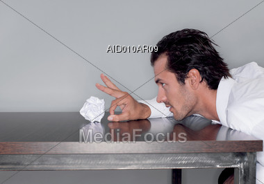 Business Man Tossing Paper Ball Stock Photo