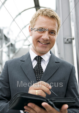 Business Man With Schedule Book - Portrait Stock Photo