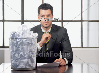 Business Man with Trash Can Stock Photo
