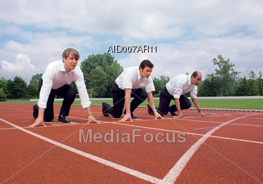 Business Men Competing in Race Stock Photo