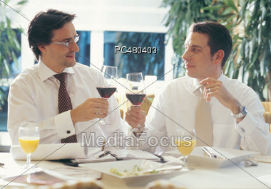 Business Men Making a Toast Stock Photo