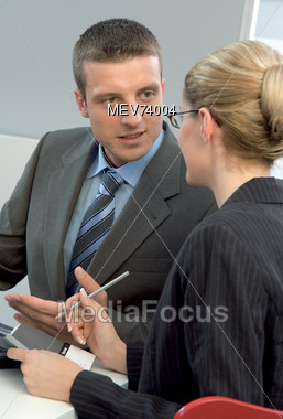 Business People Having A Discussion Stock Photo