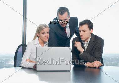 Business People Looking at Laptop Presentation Stock Photo