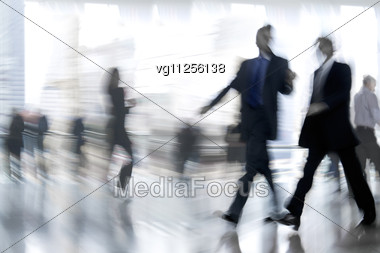 Business People Rushing In The Lobby In Motion Blur Stock Photo