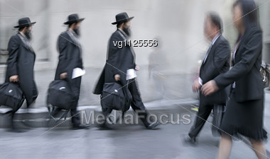 Business People Rushing On The Street In Motion Blur Stock Photo