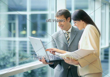 Business People with Laptop Stock Photo
