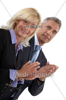 Business Professionals Clapping Their Hands Stock Photo