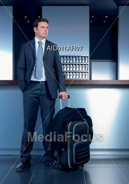 Business Traveler Waiting In Lobby Stock Photo