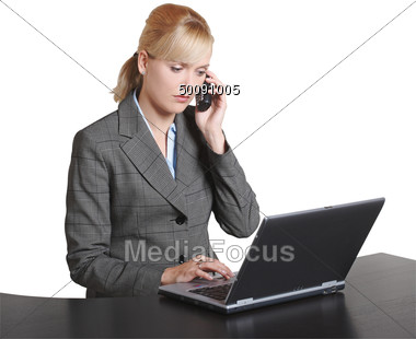 Business Woman On Cellular Phone & Laptop Stock Photo