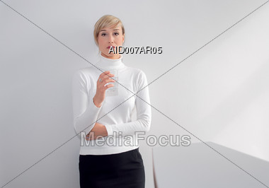 Business Woman Drinking Glass of Water Stock Photo