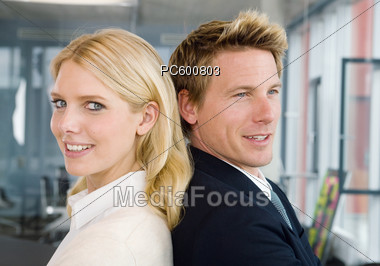 Business Women And Men At The Office, Back to Back Stock Photo