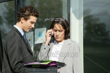 Businesscouple Stood Outside Building Stock Photo