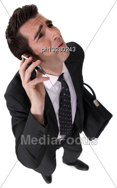 Businessman Being Nagged By His Wife Stock Photo