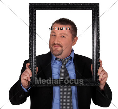 Businessman Carrying Frame In Front Of His Face Stock Photo