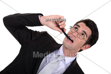 Businessman Chewing His Pen Stock Photo