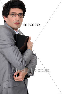 Businessman Clutching His Laptop Stock Photo
