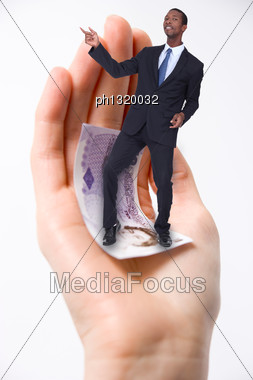 Businessman Dancing In A Palm Of A Hand Stock Photo