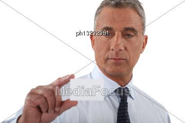 Businessman Handing His Card Stock Photo