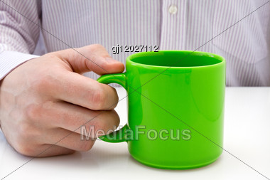 Businessman Hold A Green Cup Of Tea Stock Photo