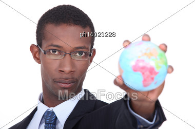 Businessman Holding A Globe Stock Photo