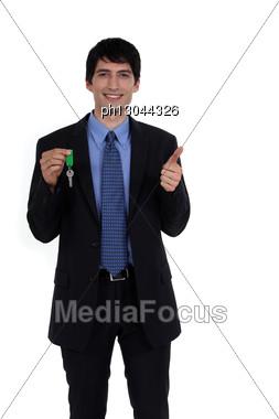 Businessman Holding A Key Stock Photo