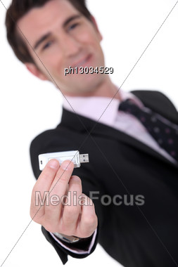 Businessman Holding A Memory Stick Stock Photo