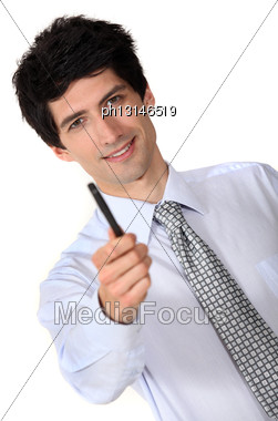 Businessman Holding Out A Pen Stock Photo