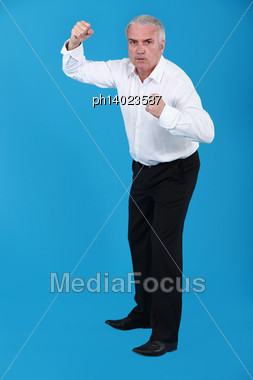 Businessman In A Fighting Stance Stock Photo