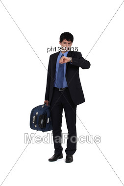 Businessman Looking At His Watch Stock Photo