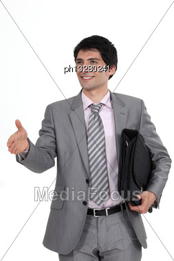 Businessman Offering His Hand Stock Photo