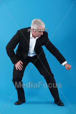 Businessman Pulling An Imaginary Object Stock Photo